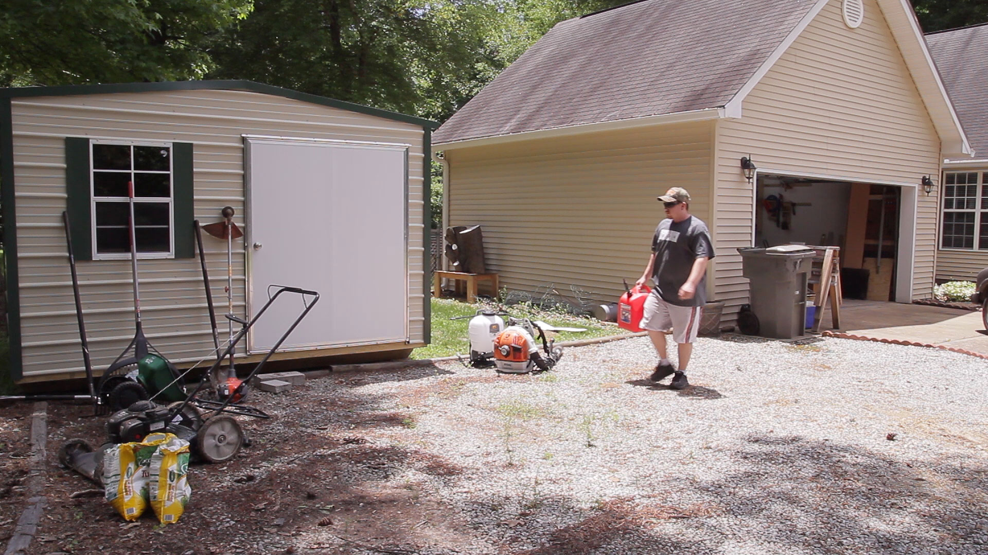 Lawn tool storage in a garden shed jays custom creations for Lawn mower shed